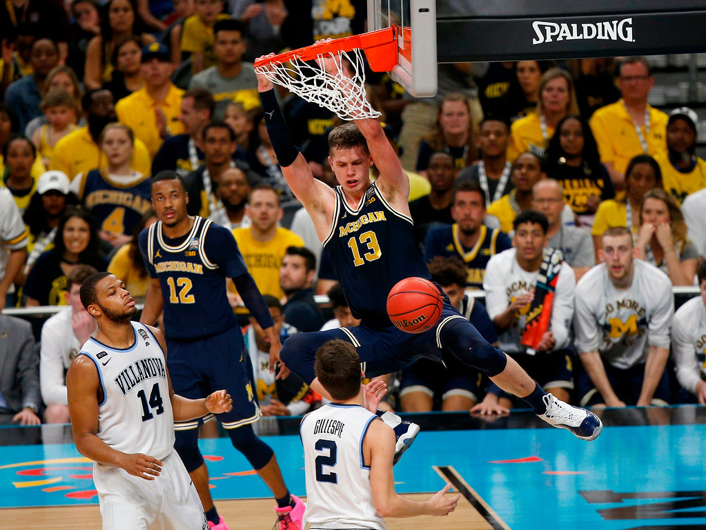 . Michigan\'s Moritz Wagner (13) dunks during the second half in the championship game of the Final Four NCAA college basketball tournament against Villanova, Monday, April 2, 2018, in San Antonio. (AP Photo/Brynn Anderson)