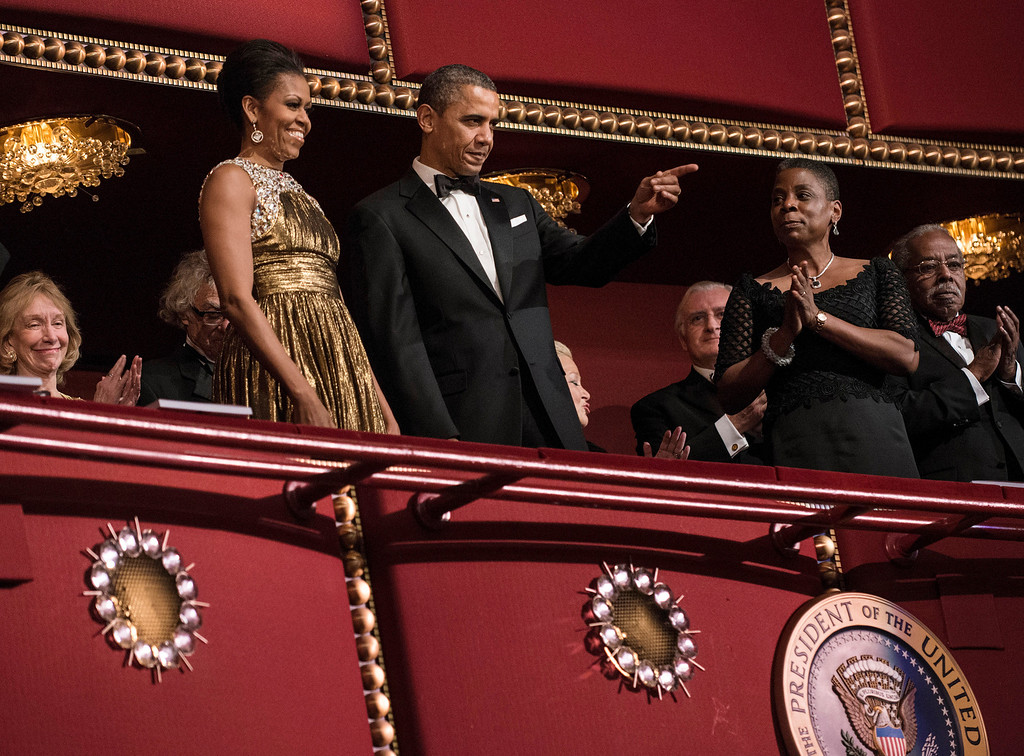 . US President Barack Obama and US First Lady Michelle Obama arrive for the 2012 Kennedy Center Honors at the Kennedy Center December 2, 2012 in Washington, DC.  Robert Plant of Led Zeppelin, Jimmy Page of Led Zeppelin, John Paul Jones of Led Zeppelin,  ballerina Natalia Makarova, comedian and late night talk show host David Letterman, actor Dustin Hoffman and Blues musician Buddy Guy were each honored for their lifetime contributions to the arts.  BRENDAN SMIALOWSKI/AFP/Getty Images