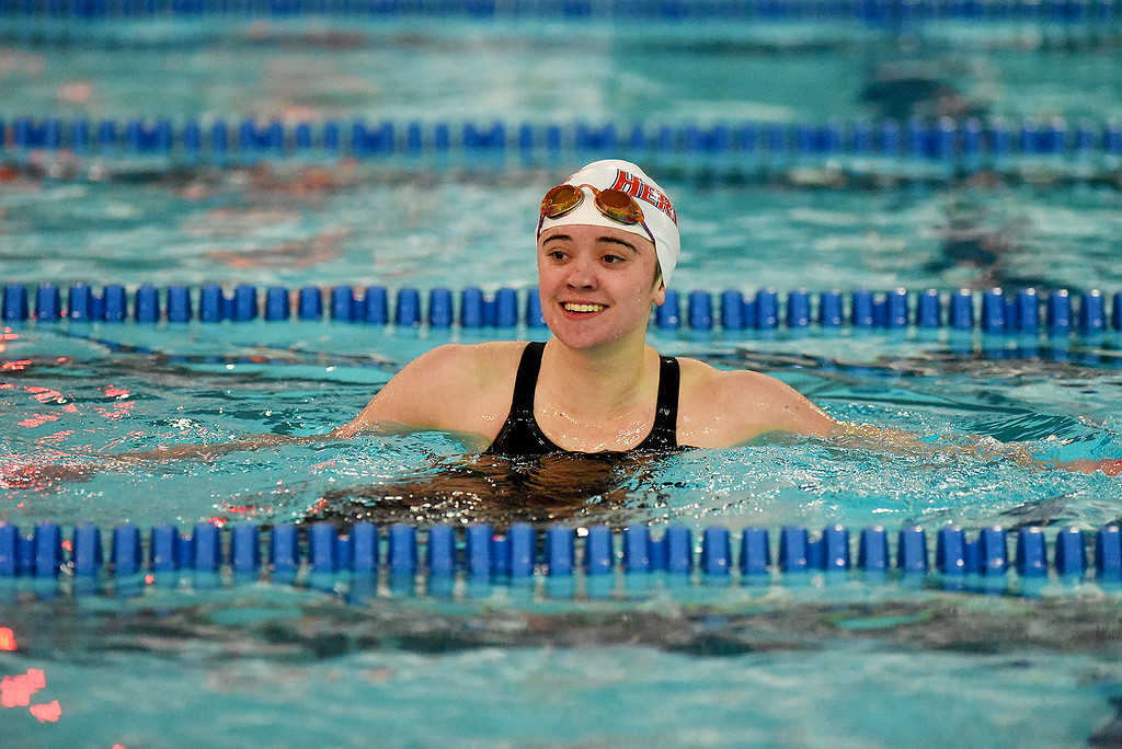 . Heritage\'s Kylie Andrews sends a smile to her coaches after winning the 100 Yard Freestyle at the girls 5A State Swim meet held at Edora Pool and Ice Center on Saturday. (Photo by Kira Horvath/ The Denver Post)