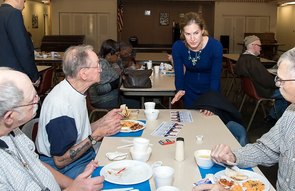 10/30/18 Wesley Bunnell | Staff Democratic candidate for Lt. Governor Susan Bysiewicz speaks with Rick Lebel, L, Frederick Calcinari and Travis Crum while enjoying lunch at the New Britain Senior Center during a visit by Democratic candidates for state office.