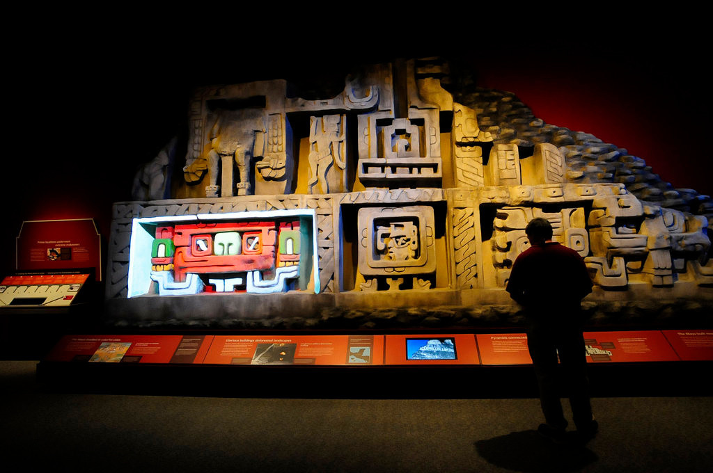 ". A replica of the west facade of the El Castillo pyramid, A.D. 600-800, at Xunantunich, Belize, is part of the ""Maya: Hidden Worlds Revealed\"" exhibit that opens Friday, June 21, 2013, at the Science Museum of Minnesota in St. Paul. Mayans built gray stone pyramids and covered them with plaster and stucco decorations painted in red and white, as seen in the lower left panel.  (Pioneer Press: Scott Takushi)"