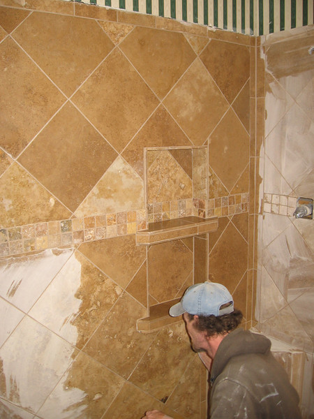 Tony's expertise as a tile layer is becoming apparent as the shower nears completion.