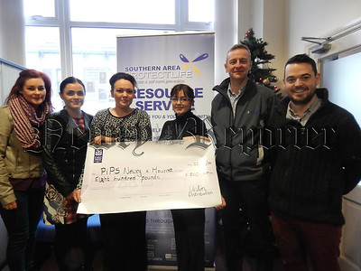 Unilin Distribution Ltd (Greenbank Ind Est, Newry) presented a cheque to PIPS Newry & Mourne. Funds were raised by employees who took part in the Oktoberfest 5K race and all money raised was matched by the Company to present a cheque for £800. Pictured are employees of Unilin Distribution presenting a cheque to Dympna Maguire of PIPS Newry & Mourne. R1503112