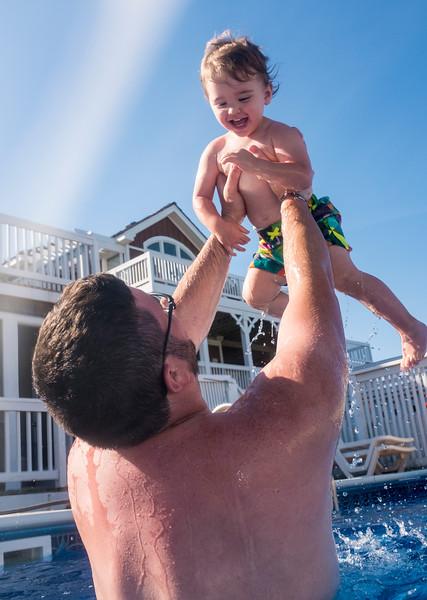 Pool-Jesse throwing Caleb in the air.jpg