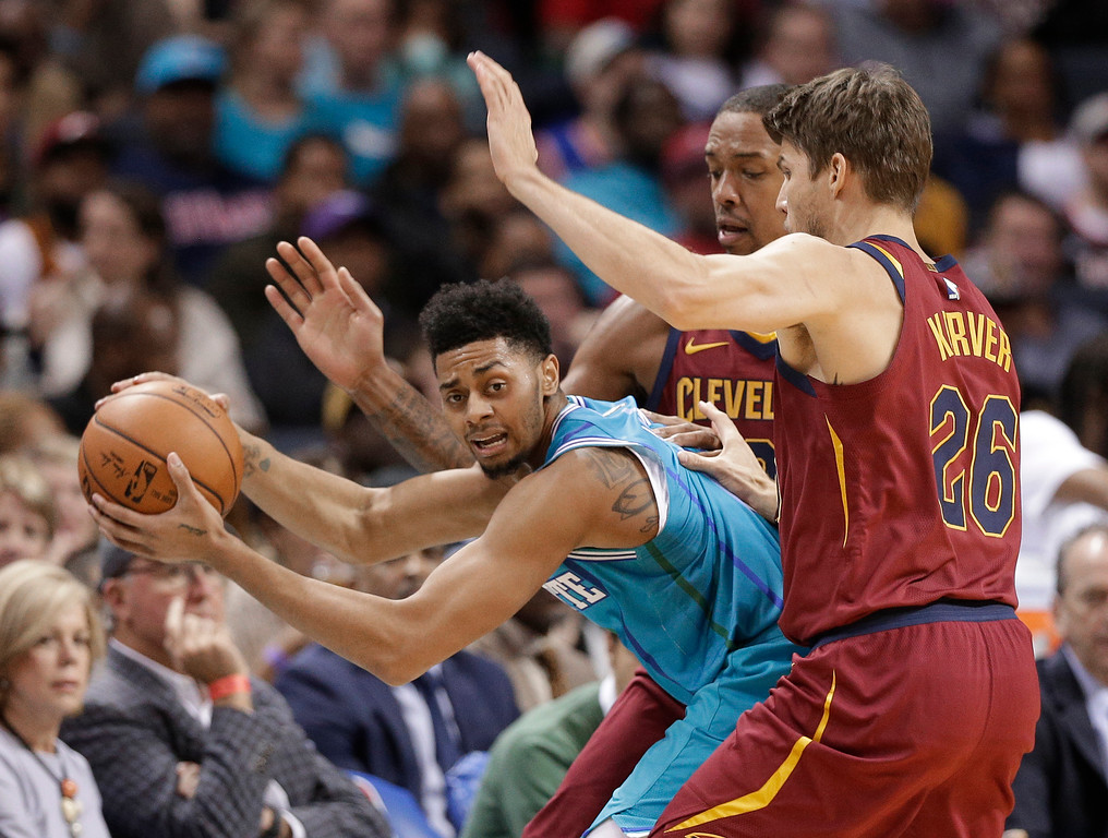 . Charlotte Hornets\' Jeremy Lamb, left, is trapped by Cleveland Cavaliers\' Kyle Korver, right, and Channing Frye, back, during the second half of an NBA basketball game in Charlotte, N.C., Wednesday, Nov. 15, 2017. (AP Photo/Chuck Burton)