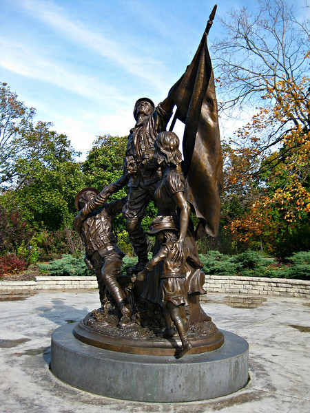 """""""The Spirit of Commitment"""" - Daily Photo - 05/24/13  I thought this was a very moving statue and wanted to include it as we approach Memorial Day.  This sculpture is located at Catigny, Wheaton, Illinois.  A wonderful place totaling 500 acres filled with gardens and best of all military equipment dedicated to the Big Red One (First Division)."""