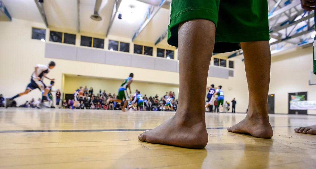 ". Triqui kids basketball team, from the mountainous region of Oaxaca, Mexico, who have been called the ""Barefoot Champions of the Mountain,\"" are known throughout their native Mexico for playing basketball without shoes took on the local Top Flight boys team at the Pacific Boys Lodge in Woodland Hills, CA Wednesday, December 18, 2013.  The Triqui team defeated Top Flight 31-29.  (Photo by David Crane/Los Angeles Daily News)"