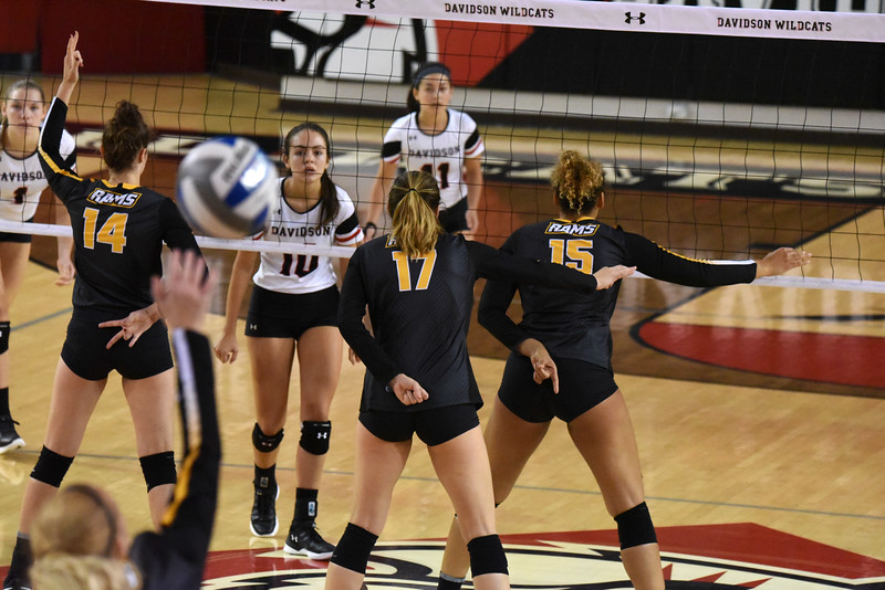 As the Davidson volleyball team await the serve from VCU, several Rams provide hand signals.