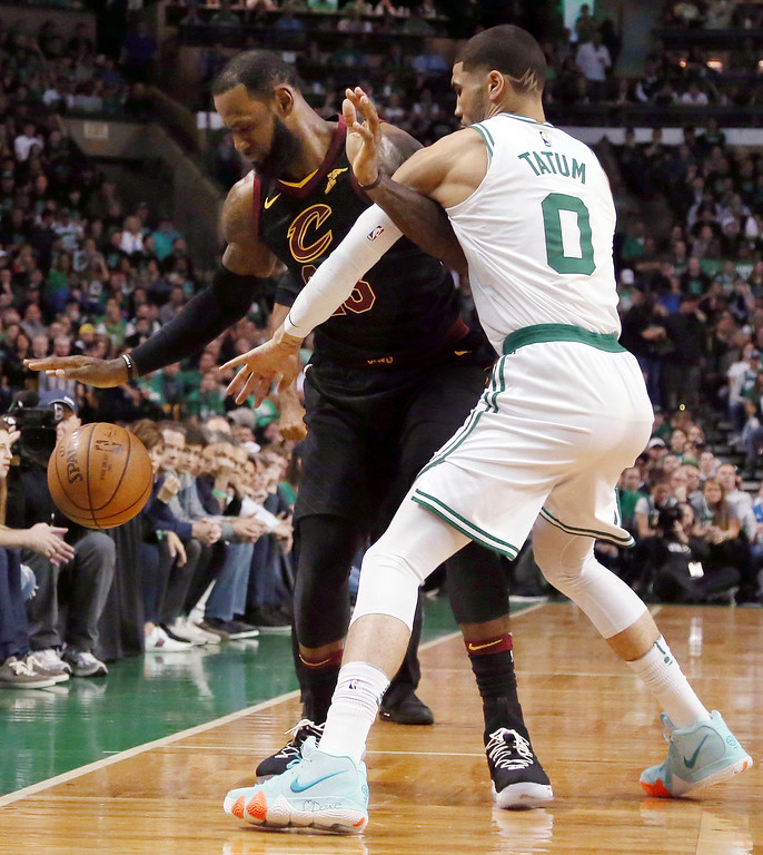 . Boston Celtics forward Jayson Tatum (0) defends against Cleveland Cavaliers forward LeBron James during the first half in Game 7 of the NBA basketball Eastern Conference finals, Sunday, May 27, 2018, in Boston. (AP Photo/Elise Amendola)