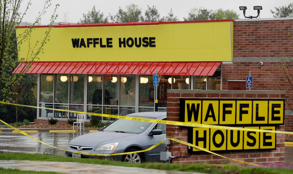 . Police tape blocks off a Waffle House restaurant Sunday, April 22, 2018, in Nashville, Tenn. At least four people died after a gunman opened fire at the restaurant early Sunday.(AP Photo/Mark Humphrey)