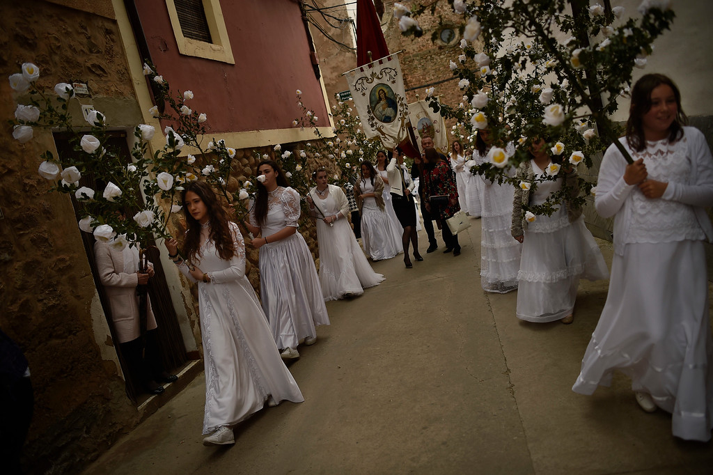 ". Participants dressed in bridal white surrounded by flowers, take part in the pilgrimage ""The Hundred Maidens\"", in Sorzano, northern Spain, Sunday, May 15, 2016. According to ancient traditions, the pilgrimage \""The Hundred Maidens\"" is in honor of the spring season and the fertility of women, today is also in honor of the Virgin Mary. (AP Photo/Alvaro Barrientos)"