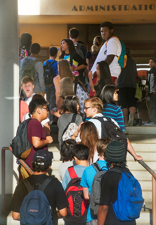 . A long line of students line up outside the Administration office at South Pasadena High School on first day back to school Thursday, August 21, 2014.  This the the campus where a 16- and 17-year-old boy allegedly planned a mass shooting to kill three staff members and as many students as possible, Police Chief Arthur Miller said. The Los Angeles County District Attorney\'s Office on Wednesday charged both boys with one count of making criminal threats. The D.A. has not charged the teens for conspiracy to commit a mass shooting, just a shooting. (Photo by Walt Mancini/Pasadena Star-News)