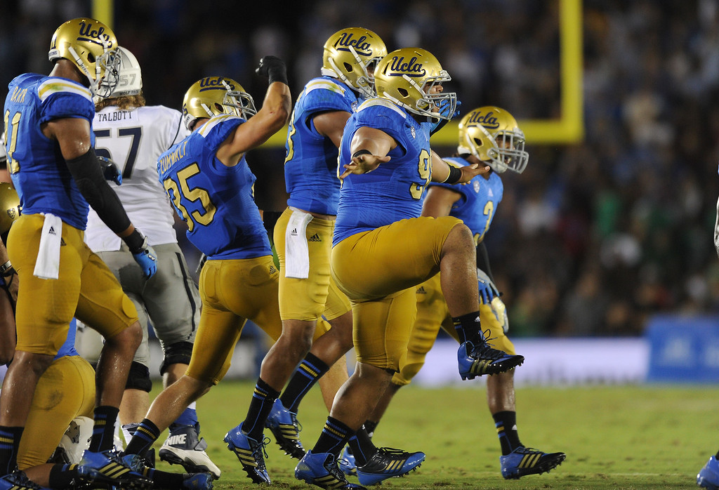 . The UCLA defense celebrates stopping Nevada on fourth down in the third quarter, Saturday, August 31, 2013, at the Rose Bowl. (Michael Owen Baker/L.A. Daily News)