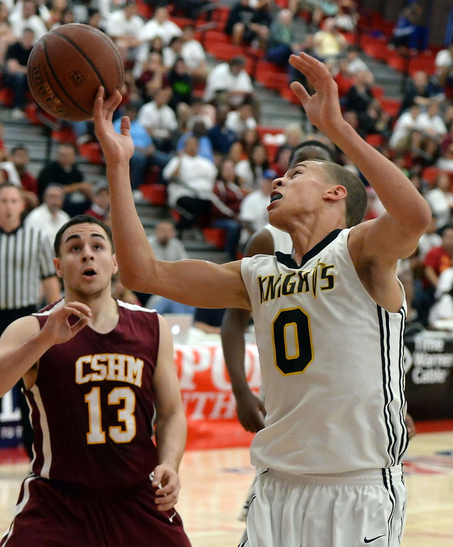 . Bishop Montgomery \'s Christian Oshita (0) rebounds past Cantwell\'s Emiliano Mejia (C) (13) in the first half of a CIF Southern California Regional Division IV basketball game at Colony High School in Ontario, Calif., on Saturday, March 22, 2014.  (Keith Birmingham Pasadena Star-News)