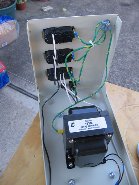 Wiring from IEC inlet is direct to receptacles. The inductor is wired in parallel.