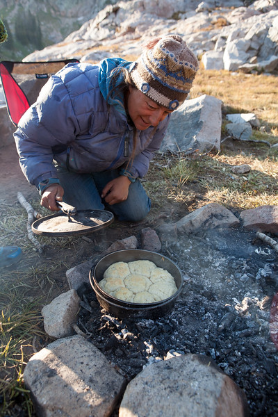 Laina, a camp cook, prepares fresh biscuits over a campfire.Just because you are in the wilderness doesn't mean you have to suffer.