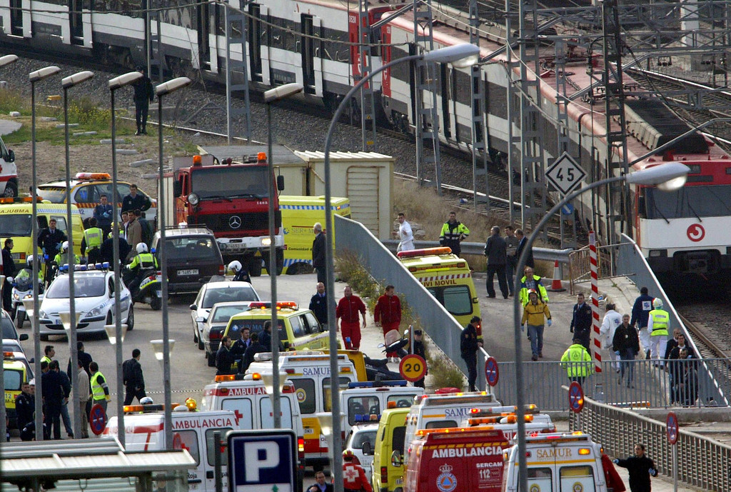 . Medics evacuate victims of a train blast from the Atocha train station in Madrid 11 March 2004. At least 131 people were killed and some 400 injured early 11 March 2004 in near-simultaneous explosions on three trains in Madrid at the height of morning commuter traffic, the Spanish interior ministry said. In what appeared to be a deliberate attack staged only 72 hours ahead of Spanish general elections, the blasts went off on a long-distance high-speed carrier and two suburban trains packed with commuters.  CHRISTOPHE SIMON/AFP/Getty Images