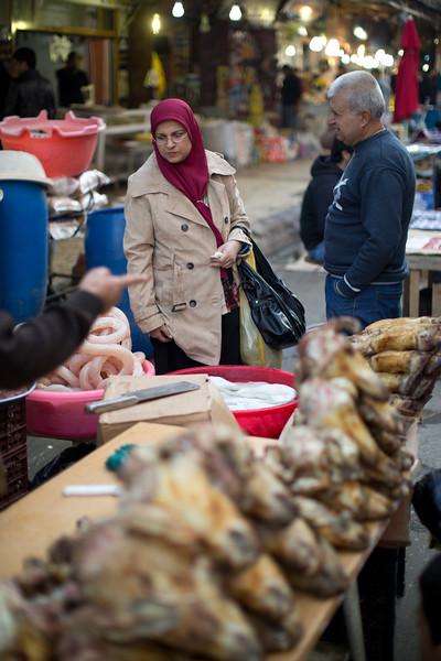 A shopper visiting a butcher at Erbil souq.
