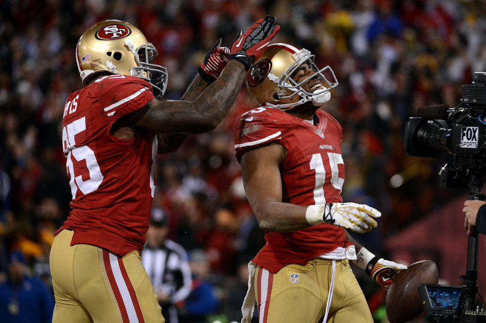 Description of . Tight end Vernon Davis #85 celebrates with Wide receiver Michael Crabtree #15 of the San Francisco 49ers after scoring a touchdown in the second quarter against the Green Bay Packers during the NFC Divisional Playoff Game at Candlestick Park on January 12, 2013 in San Francisco, California.  (Photo by Harry How/Getty Images)
