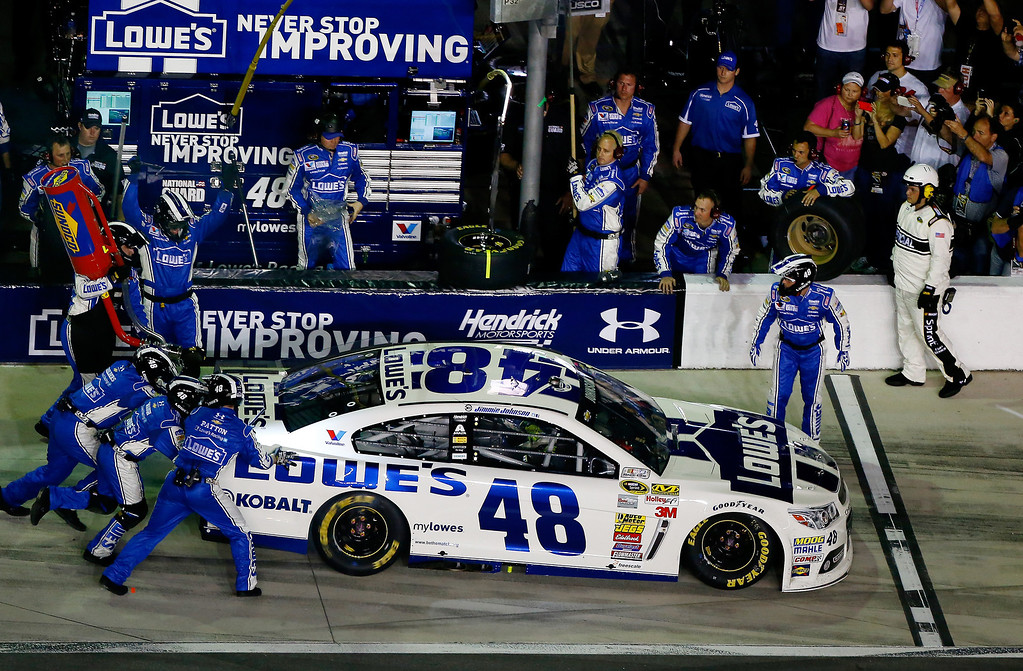 . Jimmie Johnson, driver of the #48 Lowe\'s Chevrolet, pits during the NASCAR Sprint Cup Series Budweiser Duel 2 at Daytona International Speedway on February 20, 2014 in Daytona Beach, Florida.  (Photo by Brian Lawdermilk/Getty Images)