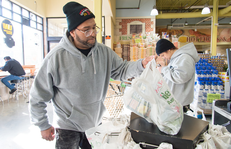 01/25/19  Wesley Bunnell | Staff  The widely used one time use plastic bags are under consideration to be banned by the City of New Britain. Here Anthony Castro lifts his groceries from the bagging area of Americas's Food Basket on Friday afternoon.