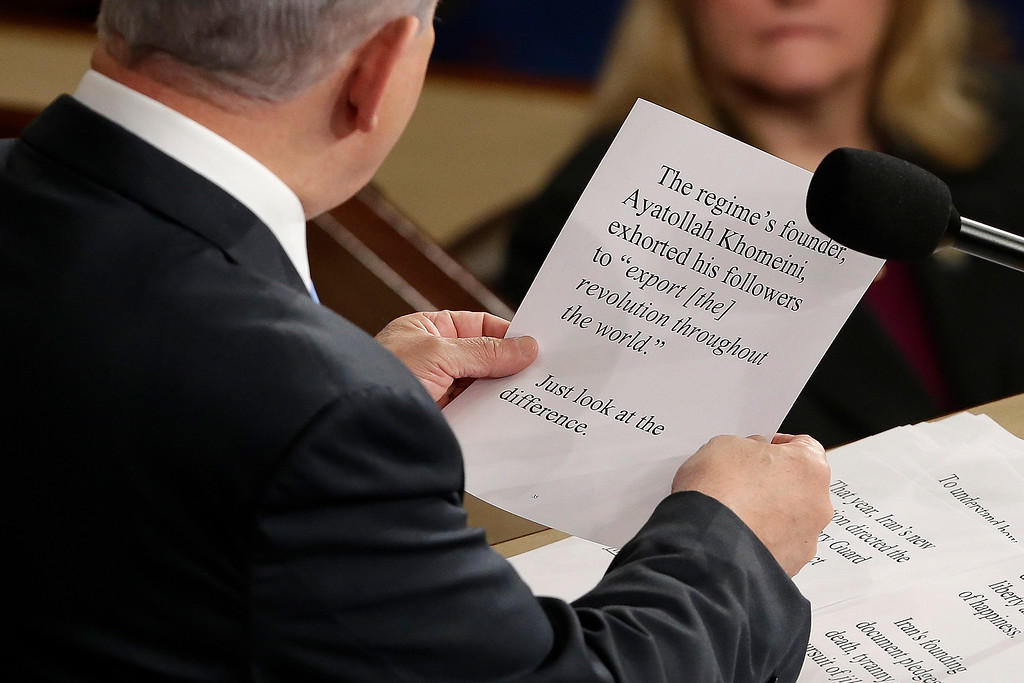 ". Israeli Prime Minister Benjamin Netanyahu holds up his script as he addresses a joint meeting of Congress on Capitol Hill in Washington, Tuesday, March 3, 2015. In a speech that stirred political intrigue in two countries, Netanyahu told Congress that negotiations underway between Iran and the U.S. would ""all but guarantee\"" that Tehran will get nuclear weapons, a step that the world must avoid at all costs. (AP Photo/J. Scott Applewhite)"