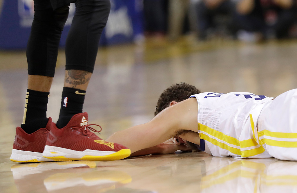 . Golden State Warriors guard Klay Thompson remains on the floor during the first half of Game 1 of basketball\'s NBA Finals between the Warriors and the Cleveland Cavaliers in Oakland, Calif., Thursday, May 31, 2018. (AP Photo/Marcio Jose Sanchez)
