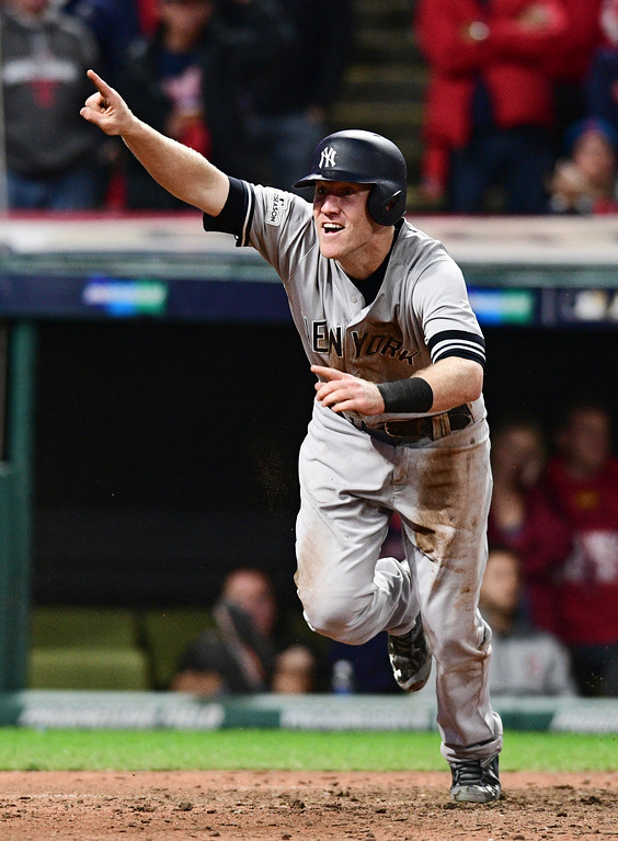 . New York Yankees\' Todd Frazier celebrates after scoring in the ninth inning against the Cleveland Indians in Game 5 of a baseball American League Division Series, Wednesday, Oct. 11, 2017, in Cleveland. (AP Photo/David Dermer)