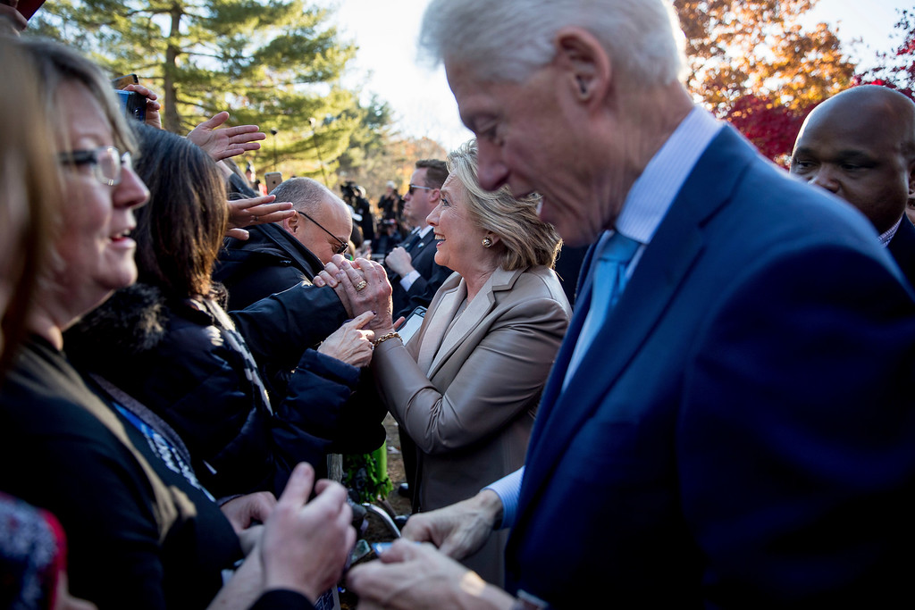 . Democratic presidential candidate Hillary Clinton, accompanied by her husband, former President Bill Clinton, greets supporters outside Douglas G. Grafflin School in Chappaqua, N.Y., Tuesday, Nov. 8, 2016, after voting. (AP Photo/Andrew Harnik)