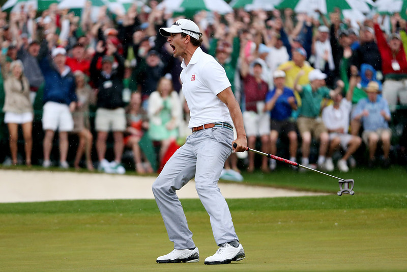 . Adam Scott of Australia celebrates after making a birdie on the 18th hole during the final round of the 2013 Masters Tournament at Augusta National Golf Club on April 14, 2013 in Augusta, Georgia.  (Photo by Andrew Redington/Getty Images)