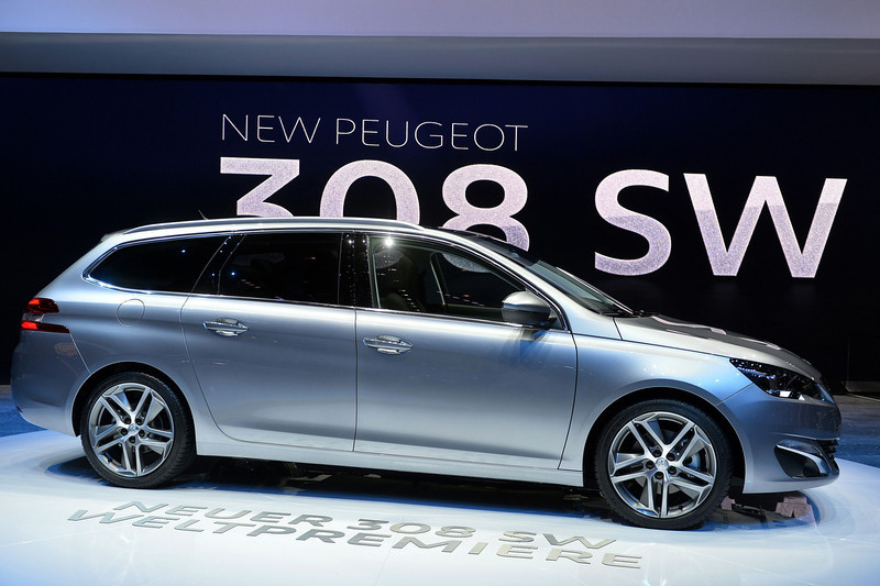 . The new Peugeot 308 SW model car is displayd at the French carmaker\'s booth during the press day of the Geneva Motor Show in Geneva, on March 4, 2014.  FABRICE COFFRINI/AFP/Getty Images