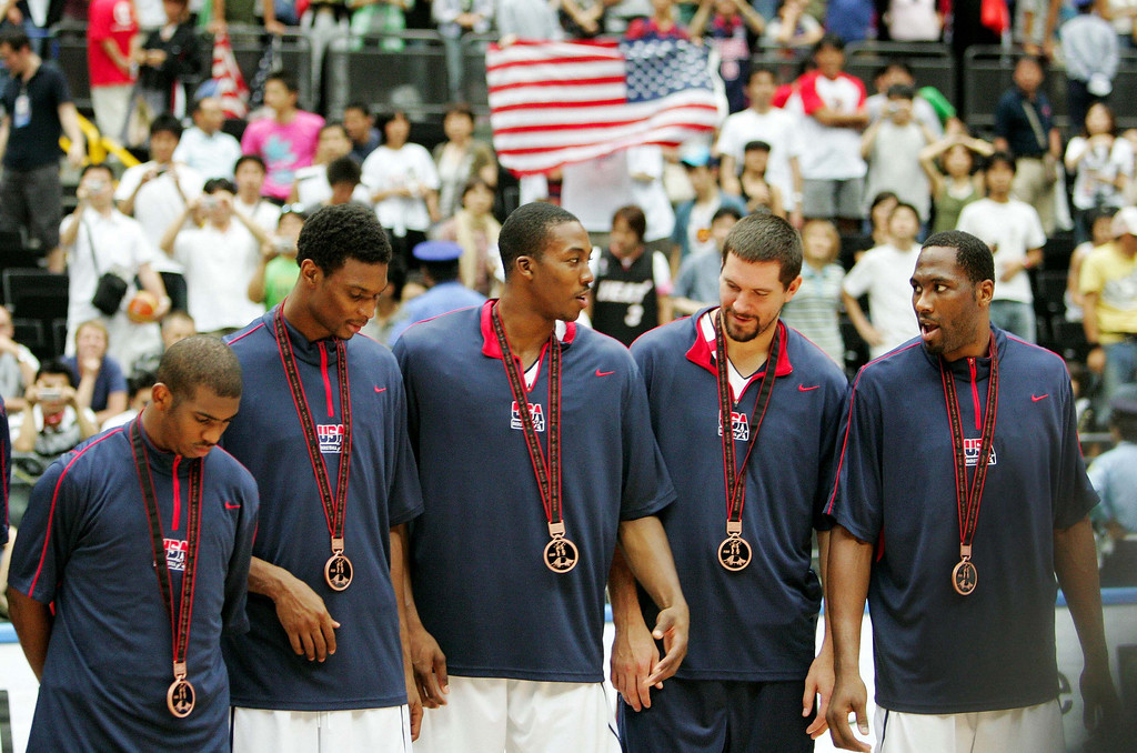 . USA team members, from left, Chris Paul, Chris Bosh, Dwight Howard, Brad Miller and Elton Brand stand with their bronze medals after defeating Argentina in the 3rd place final at the world basketball championships, Saturday, Sept. 2, 2006, in Saitama, Japan. (AP Photo/Mark J. Terrill)