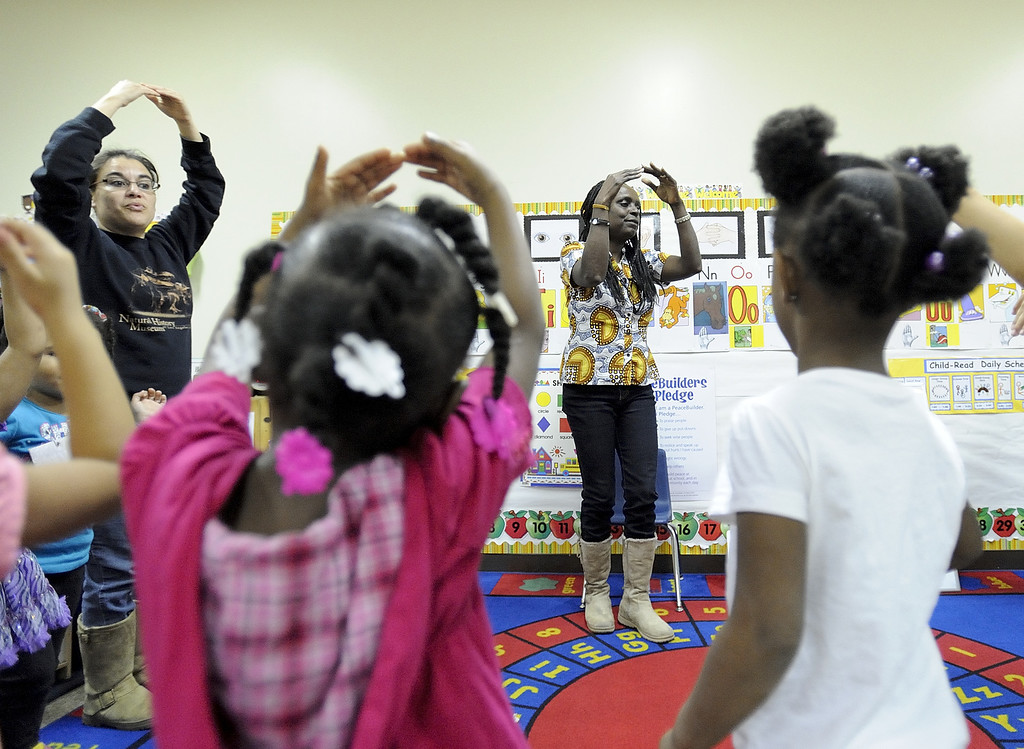 . LONG BEACH, CALIF. USA -- Teacher Angela Hullett leads movement time with students at Pine Head Start in Long Beach, Calif., on February 25, 2013.  Photo by Jeff Gritchen / Los Angeles Newspaper Group