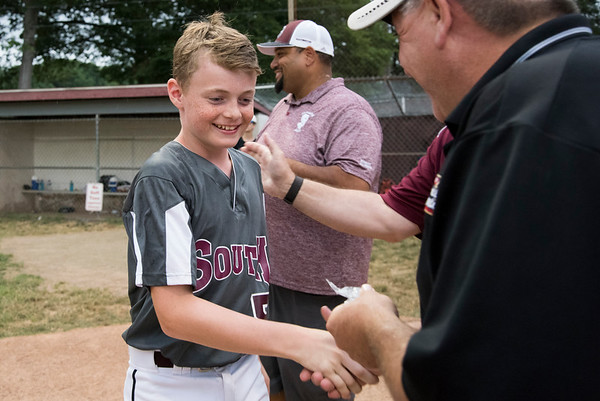 07/11/19 Wesley Bunnell | Staff Southington South Little League was defeated by Farmington on Thursday evening at Carl Verderame Memorial Field in Southington. Gabe HInkson (5) receives a little league pin.