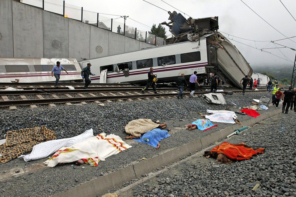 . A picture taken on July 24, 2013 shows the bodies of victims covered with blankets as rescuers work at the site of a train accident near the city of Santiago de Compostela.  AFP PHOTO / LA VOZ DE GALICIA / XOAN A. SOLER / MONICA FERREIROSMONICA FERREIROS, XOAN A. SOLER/AFP/Getty Images