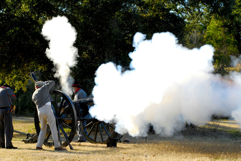 Reenactors with the 13th Battalion, North Carolina Light Infantry, D-Company perform a firing demonstration of a 10-pound Parrot canon at the 146th Anniversary of the Fall of Ft. Anderson in Brunswick Town, North Carolina on Sunday, February 20, 2011. Photo Copyright 2011 Jason Barnette