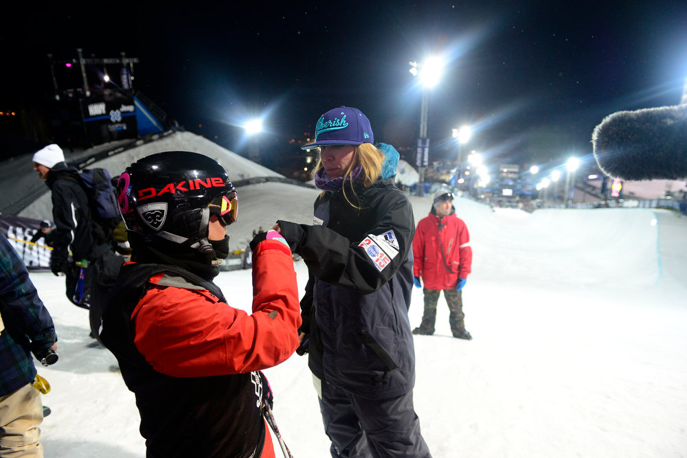 Description of . ASPEN, CO. - JANUARY 24: Elana Chase talks to Anais Caradeux about her run during warmup for the women's ski superpipe final. X Games Aspen Buettermilk Mountain Aspen January 25, 2013 (Photo By AAron Ontiveroz / The Denver Post)