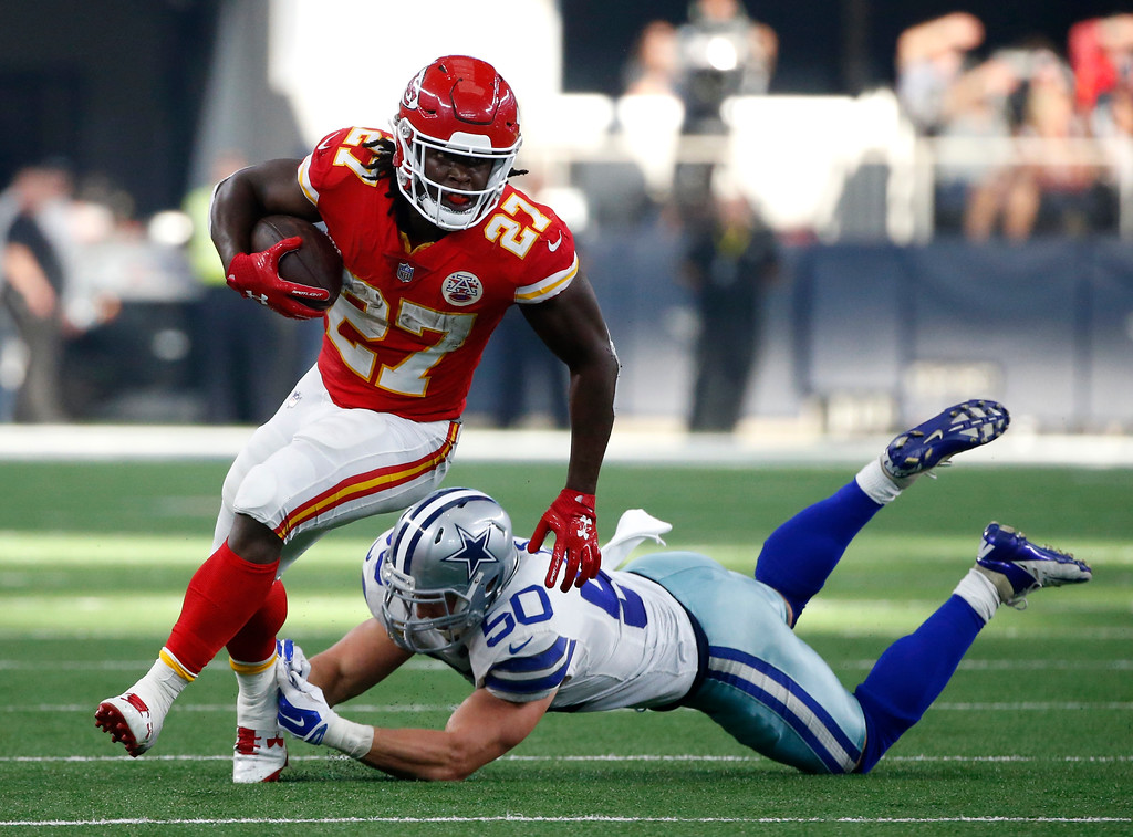 . Kansas City Chiefs running back Kareem Hunt (27) escapes a tackle attempt by Dallas Cowboys linebacker Sean Lee (50) in the first half of an NFL football game, Sunday, Nov. 5, 2017, in Arlington, Texas. (AP Photo/Michael Ainsworth)