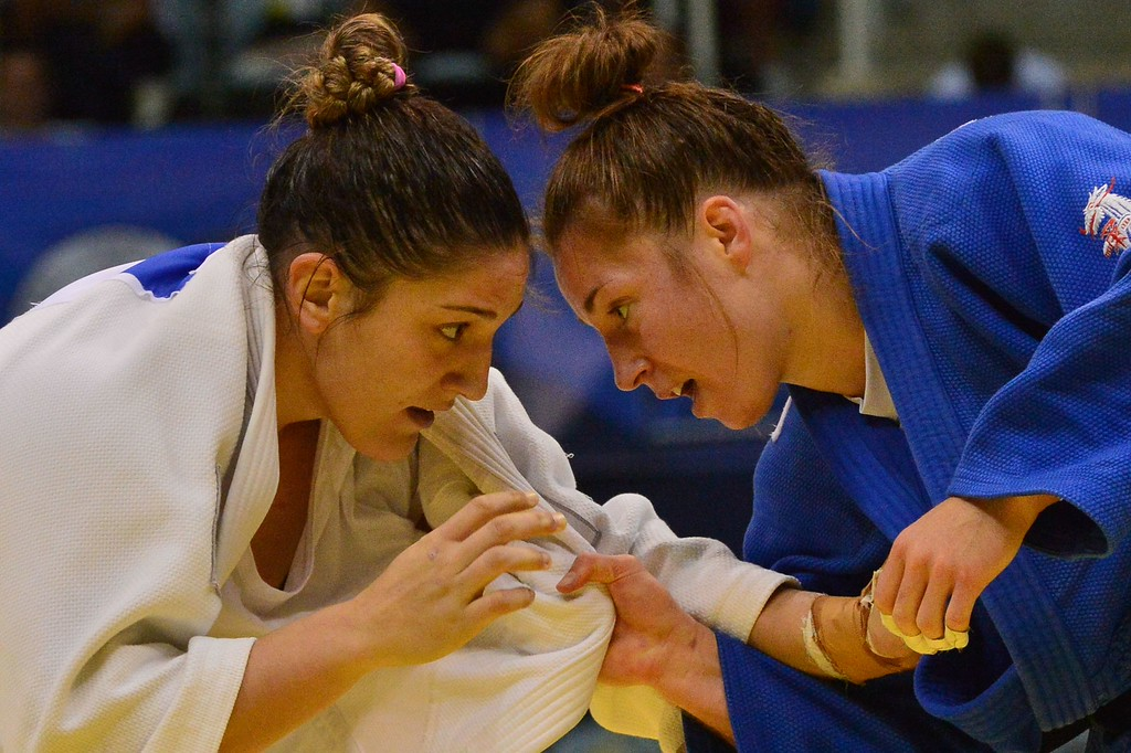 . Brazil\'s Mayra Aguiar (in white) competes with the Netherlands\' Marhinde Verkerk  during the women\'s 78kg category of the IJF World Judo Championship in Rio de Janeiro, Brazil, on August 30, 2013. YASUYOSHI CHIBA/AFP/Getty Images
