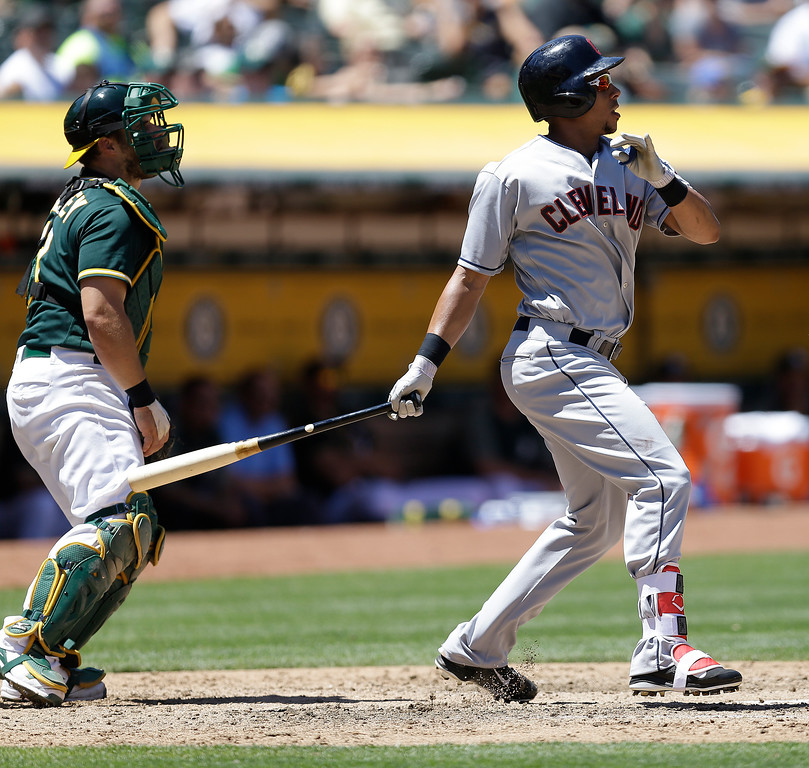 . Cleveland Indians\' Michael Brantley swings for a two un single against the Oakland Athletics in the fourth inning of a baseball game, Sunday, July 16, 2017, in Oakland, Calif. (AP Photo/Ben Margot)
