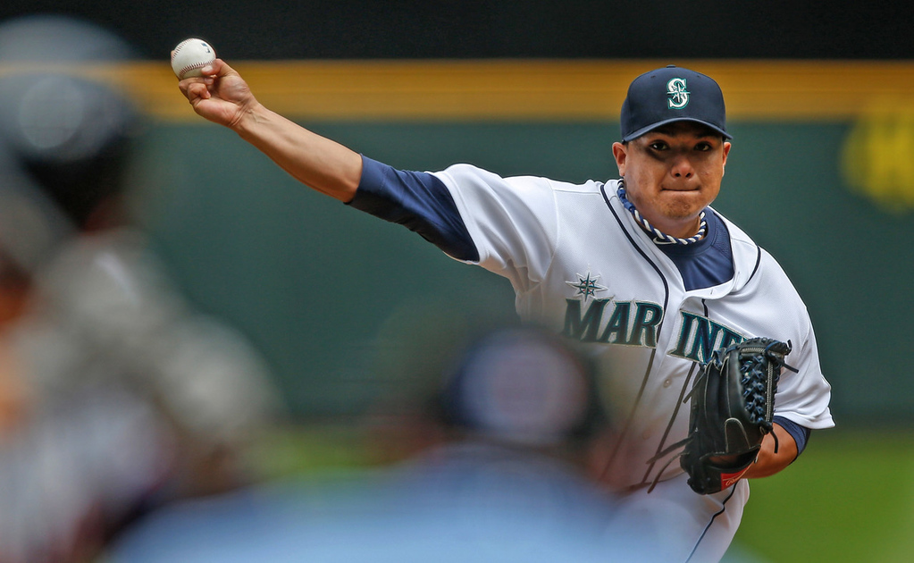 . Mariners starter Erasmo Ramirez delivers against the Twins during the fifth inning.  (Photo by Otto Greule Jr/Getty Images)