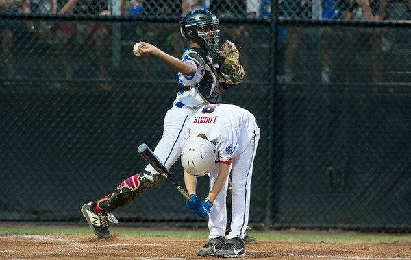08/09/19 Wesley Bunnell | Staff New Jersey defeated Washington, DC on Friday August 9, 2019 in a Little League Baseball Eastern Regional Tournament game with New Jersey heading to the final on Saturday to face New York. New Jersey catcher Joel Sanchez (13) throws down to third base as DC's Jackson Loomis (9) reacts to striking out.