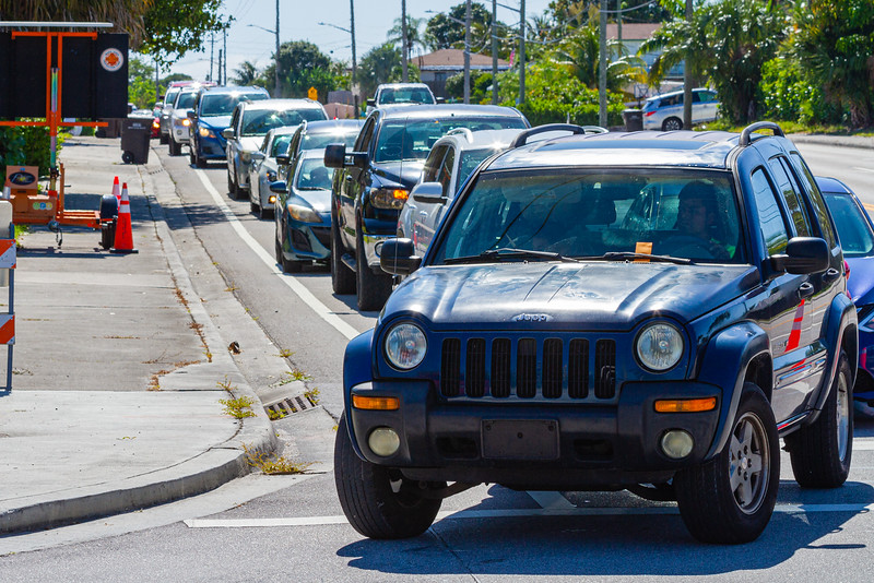 Cars line Summit Blvd. waiting to get into Dreher Park where the Tree of Life Resource Center  hosted a drive thru community food distribution event in West Palm Beach, Tuesday, May 5, 2020.  The event was sponsored by Schumacher Automotive Group. It was estimated that about 500 cars passed through the site in Dreher Park and about 600 families received food which included produce, meats and diary and  non-perishables food items. [JOSEPH FORZANO/palmbeachpost.com]
