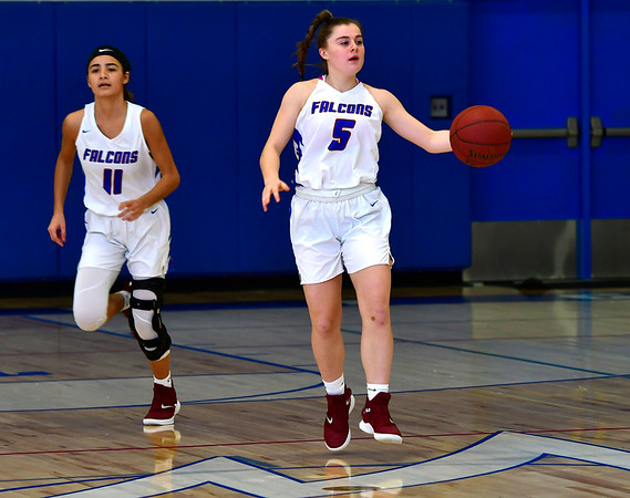 1/2/2019 Mike Orazzi | Staff St. Paul Catholic High School's Janessa Gonzalez (11) and Emma Cretella (5) during Wednesday night's girls basketball game with Sacred Heart in Bristol.