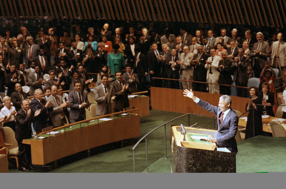 ". Nelson Mandela deputy President of the African National Congress is applauded as he prepares to address the Special Committee against Apartheid in the United Nations General Assembly Friday, June 22, 1990 in New York.    Mandela called South Africa\'s policy of apartheid a ""crime against humanity.\""   (AP Photo/Ron Frehm)"