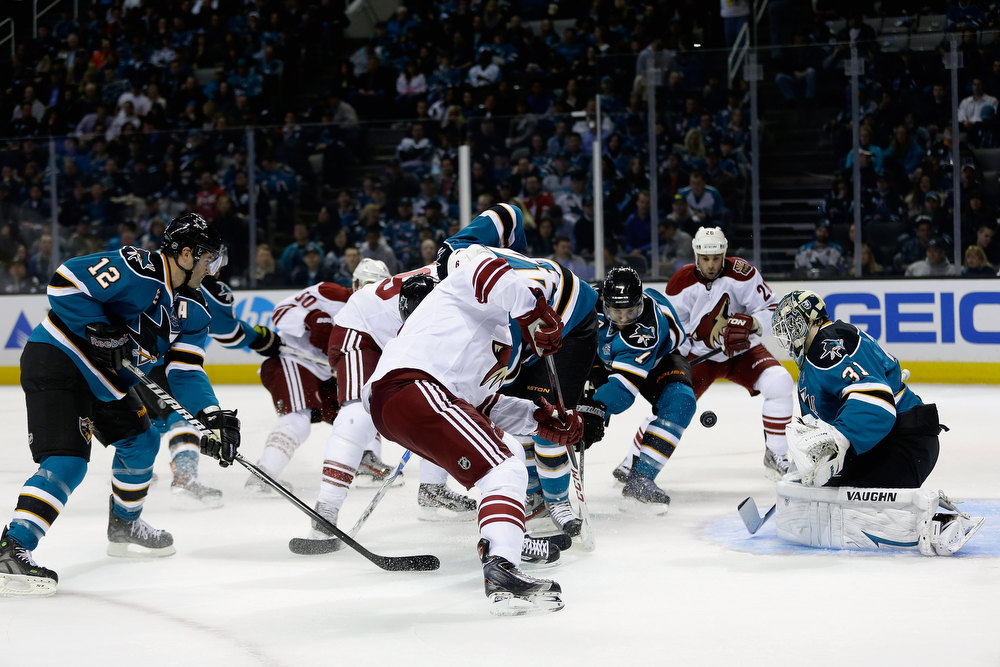 . SAN JOSE, CA - JANUARY 24:  The Phoenix Coyotes try to score on Antti Niemi #31 of the San Jose Sharks at HP Pavilion on January 24, 2013 in San Jose, California.  (Photo by Ezra Shaw/Getty Images)