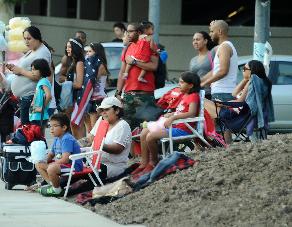 . July 4,2013 Woodland Hills.  Warner Center Park got so pack that people had to start grabbing spots across the street on dirt during the July Fourth Fireworks Extravaganza: Keyes Automotive Group co-sponsors the event with music by the Los Angeles Pierce Symphonic who performed  Photo by Gene Blevins/LA Daily News