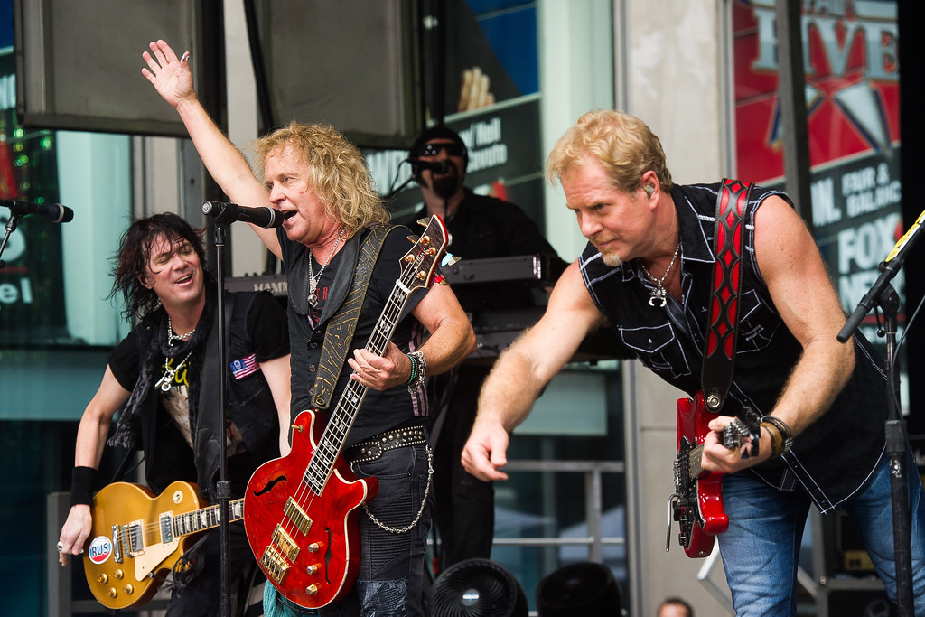""". Keri Kelli, left, Jack Blades and Brad Gillis from the band \""""Night Ranger\"""" performs on \'FOX and Friends\' All American Summer Concert Series on Friday, Aug. 21, 2015, in New York. Night Ranger will perform Dec. 15 at the Hard Rock Rocksino at Northfield Park. For more information, visit www.hrrocksinonorthfieldpark.com. (Photo by Charles Sykes/Invision/AP)"""