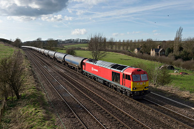 DB Class 66063 on afternoon Kingsbury to Lindsey Refinery passes New Barnetby
