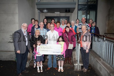 Kellie Crawford presents a cheque to members of the Brain Injury Foundation for £540. Kellie donated her hair to the Little Princess Charity and received sponsorship which was given to the charity. R1521008